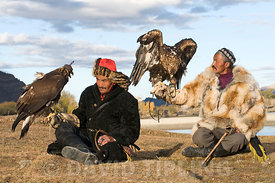 Kazakh eagle hunters with their Golden Eagles Bayan-Ulgii in Altai Mountains western Mongolia
