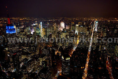 Over midtown New York, night aerial view.
