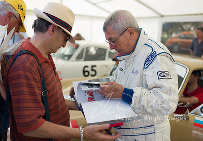 Racing legend Vic Elford, signing autographs in the Porsche garage - Goodwood Festival of Speed 2013