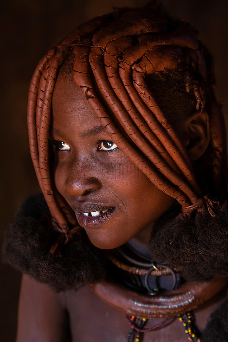 Portrait of a Himba Girl in the Doorway of her Hut