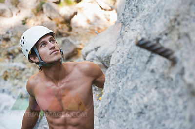 Austria, Steiermark, Ramsau, Silberkarklamm, Man rock climbing, close up