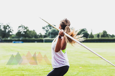 Young woman throwing javelin