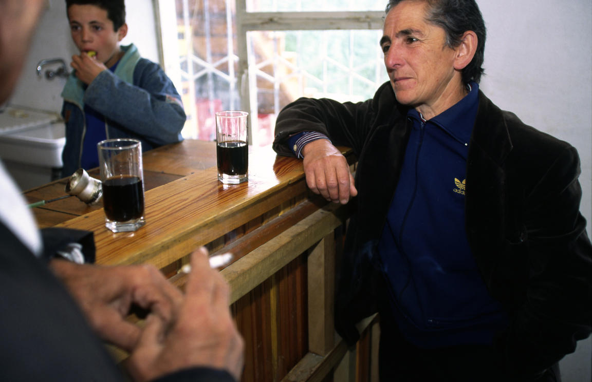 Albania - Thethi - Pashke Sokol Ndocaj at the village bar where she drinks with the men