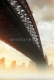 An atmospheric image of the Sydney Harbour Bridge in Australia, on a misty morning.