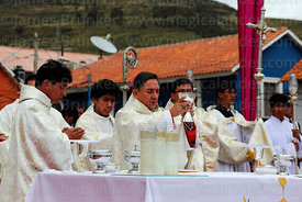 Bishop of Puno Jorge Carrion Pablisch blessing wine during central mass, Virgen de la Candelaria festival, Puno, Peru