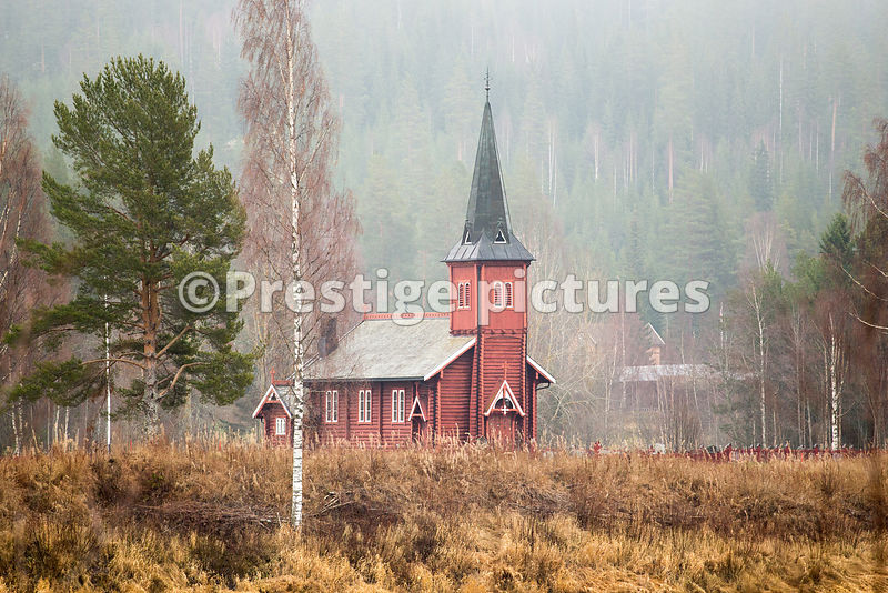 Red wooden church building in a small community