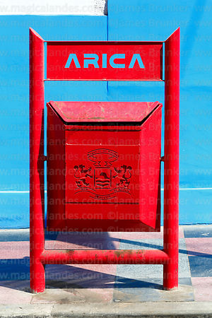 Red rubbish bin with city coat of arms, Arica, Region XV, Chile