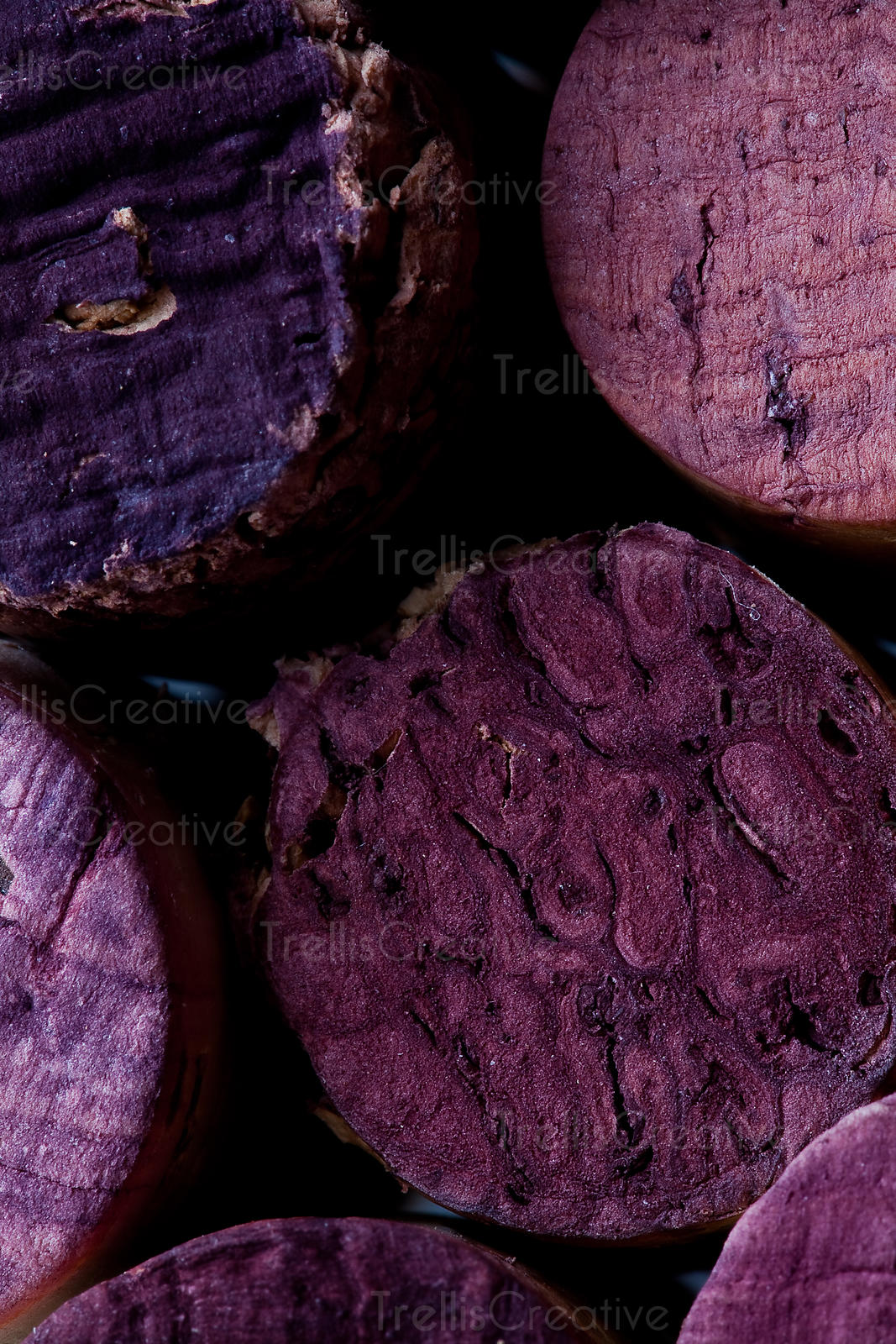 Close-up of stained purple wine corks bunched together