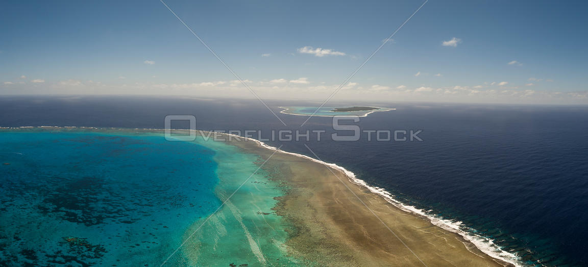 Aerial view of Vuata Vatoa Reef looking towards Vatoa Island, also known as Turtle Island by Captain Cook, Lau Island Group, ...