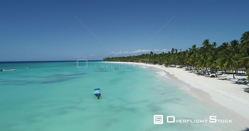 Caribbean beach and palm trees. Low altitude flight forward . Saona Island, Dominican Republic