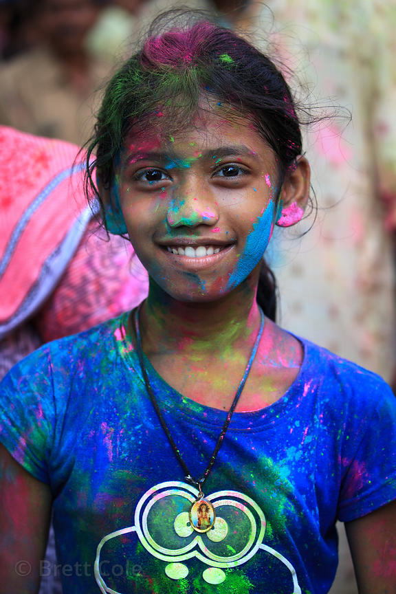 Children covered in brightly colored powder during Ganesh Chaturthi festival celebrations on Chowpatty Beach, Mumbai, India.