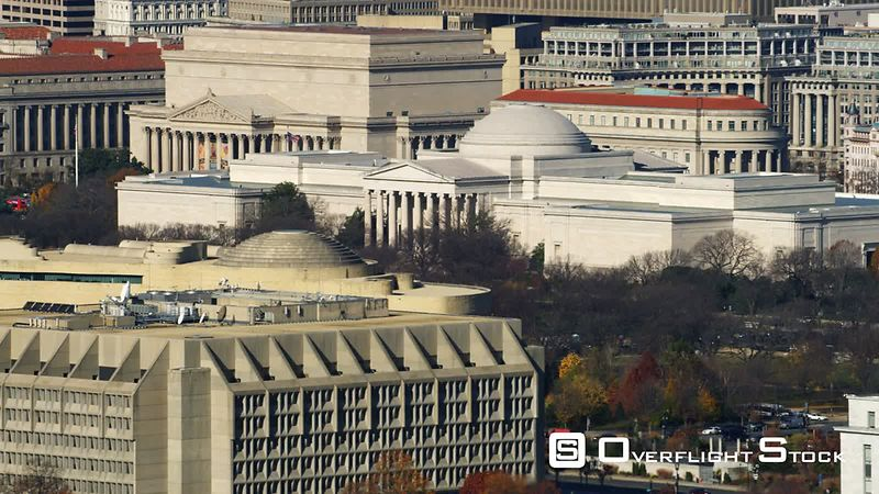 Flying past National Gallery of Art toward Old Post Office in Washington DC  Department of Justice Building in center frame a...