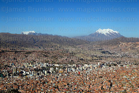View of city and Mts Mururate (L) and Illimani (R), seen from Sallahumani viewpoint at La Ceja, La Paz, Bolivia