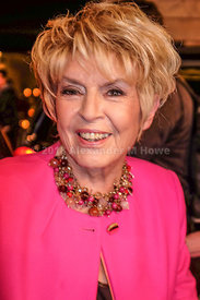 Gloria Hunniford smiling wearing  big necklace and pink jacket royalty free stock photo library