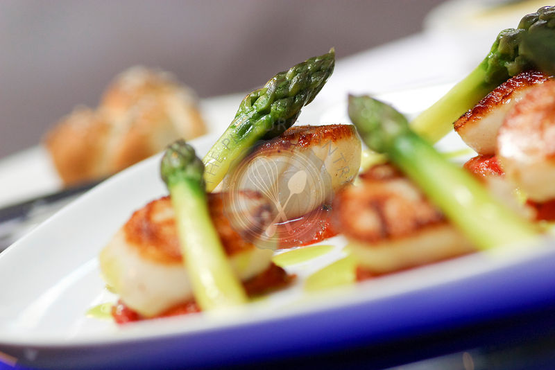 Food is caramalised Isle of Skye king scallops, tomato confit, green asparagus, basil butter sauce.