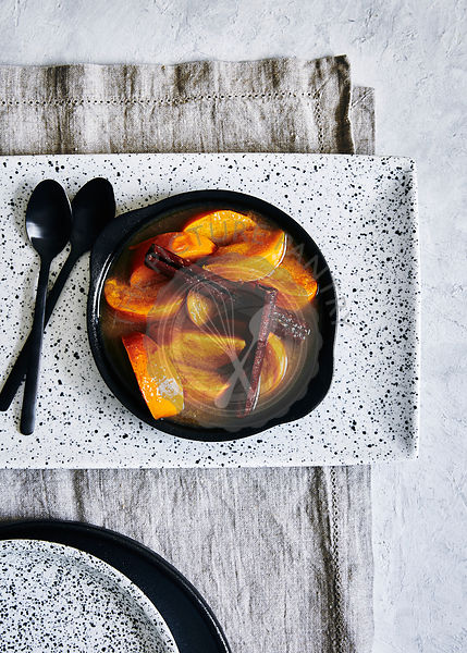 Stewed persimmon fruit in cinnamon and vanilla.