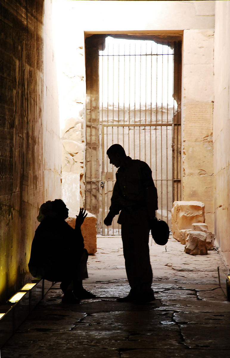 Guard Talking With a Woman