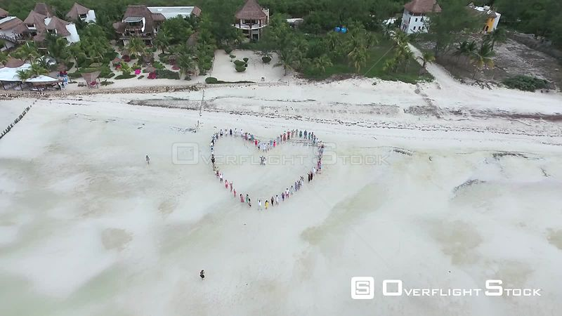 Wedding Guests Make a Heart on Beach. Holbox Mexico