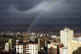 Rainbow over Sopocachi and Miraflores (in background) districts in rainy season, La Paz, Bolivia