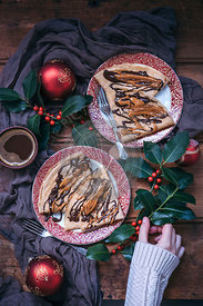 Festive Christmas crepes topped with melted dark chocolate and peanut butter