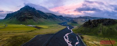 Aerial panoramic of river and mountains at sunset, Iceland