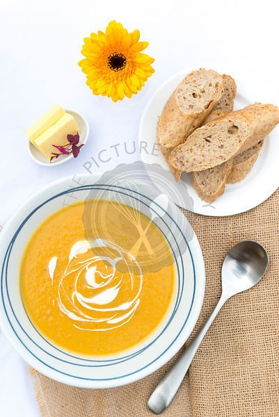 Butternut squash soup served with bread.