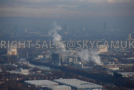 Manchester aerial photograph of winter haze and industrial steam plumes rising into the cold air from factories in Trafford Park