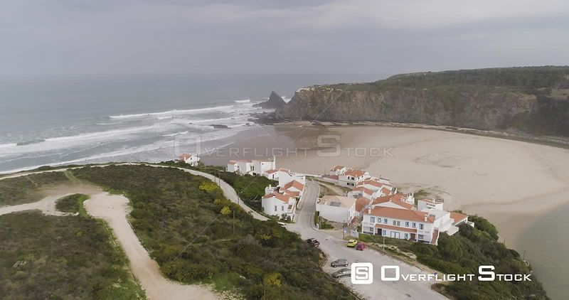 Aerial drone flying over a small village on a beautiful beach off the coast of Portugal