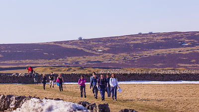 Walkers on Longstone Moor Peak District