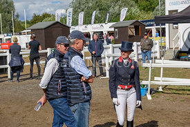Piggy French discusses her dressage test with Chris Bartle and Dickie Waygood