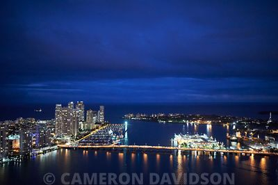 Aerial photograph of the MacArthur Causeway in Miami, Florida at night.