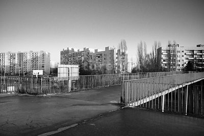 An atmospheric image of an empty bridge on a housing estate.