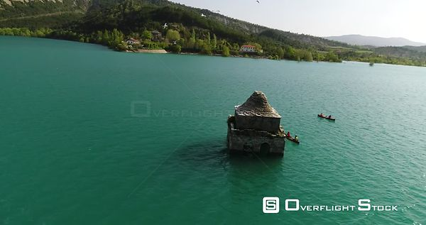 Canoeing on Embalse de Mediano. Church Tower on Submerged Village Spain