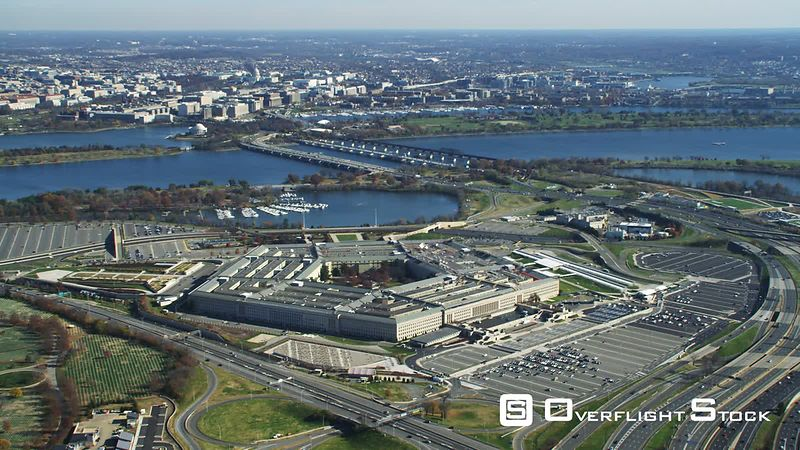 Wide view of the Pentagon with Washington DC across river in background.