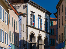 Town hall and colored facades of Cunlhat, France