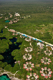 Aerial view of the tourist resorts and cenotes - freshwater holes - located all over the Yucatan peninsula, Mexico