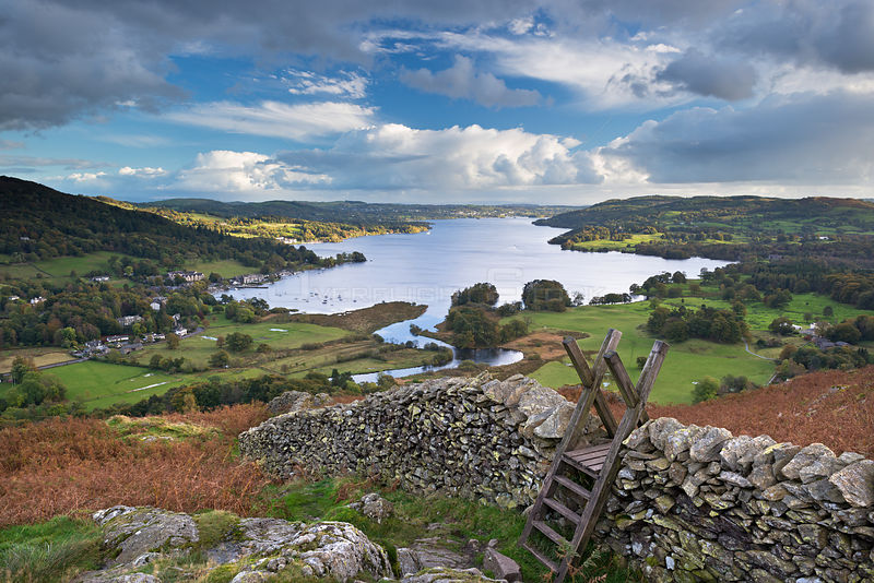 Footpath stile over dry stone wall, overlooking Lake Windermere, Lake District, Cumbria, England. Autumn (October) 2012