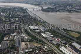 Runcorn aerial photograph of Astmoor Industrial Estate Astmoor road with the river Mersey and the Runcorn Bridge in the backg...