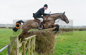The Hon. Johnny Greenall jumping a hedge above Chadwell