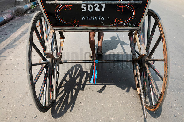 Rear View of a Hand-Pulled Rickshaw in the Streets of Calcutta