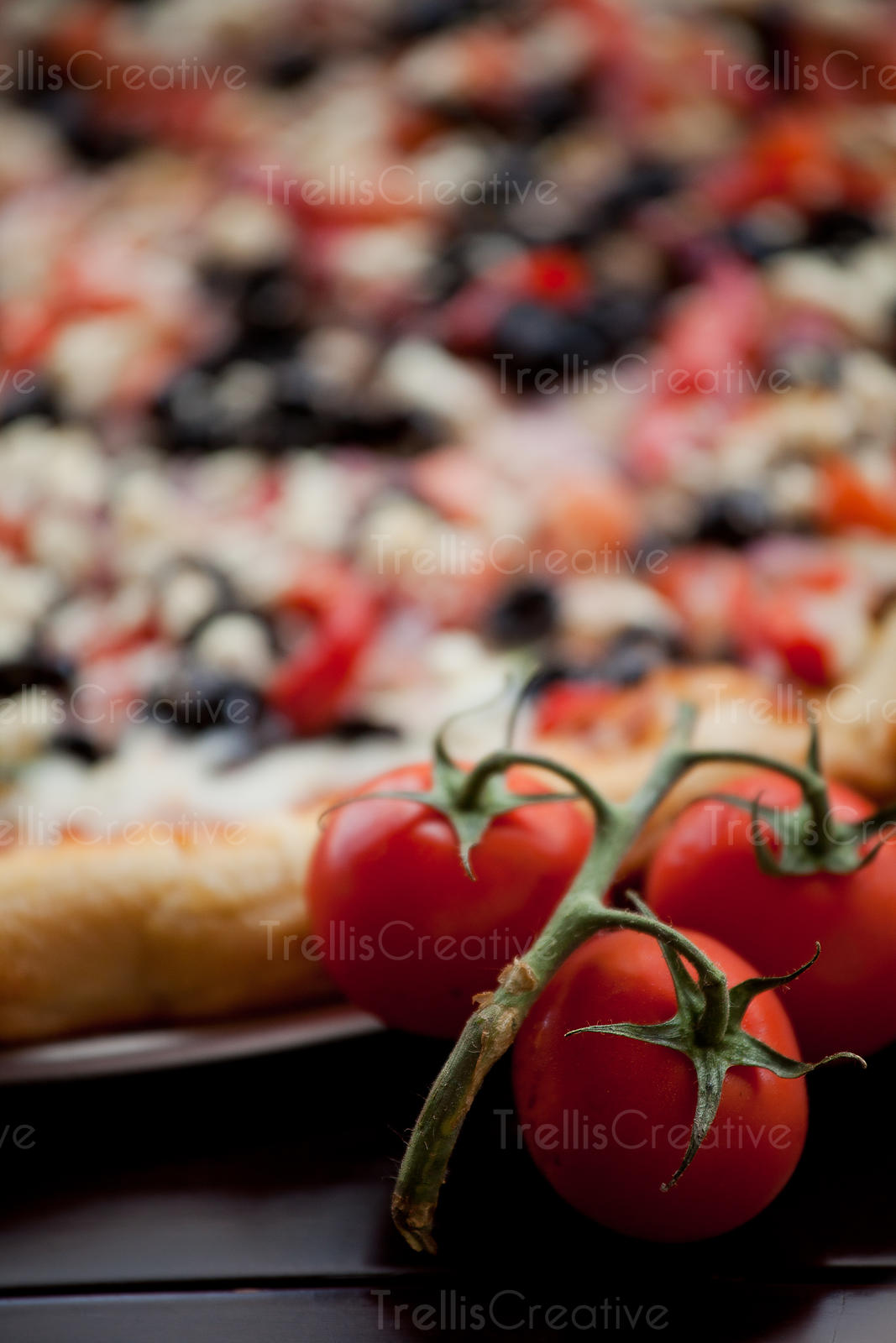 Close-up of a delicious pizza crust and vibrant red cherry tomatoes