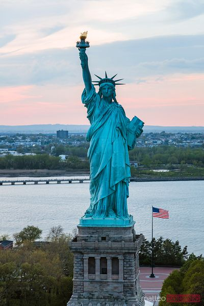 Aerial of the Statue of Liberty at sunset, New York city, USA