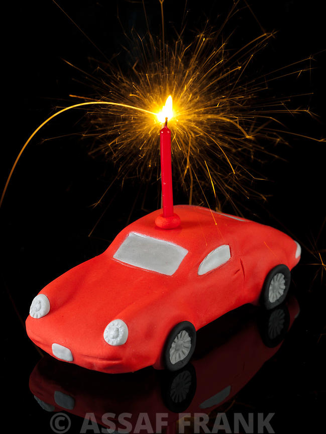 Car birthday cake with a sparkler