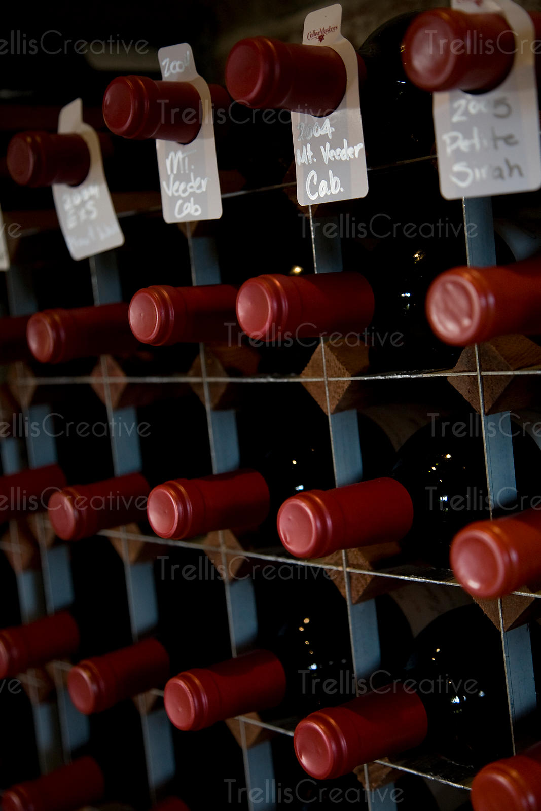 A wine rack filled with bottles of red wine