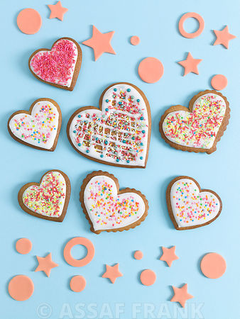 Heart shape biscuits on blue background