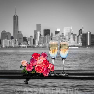 Champagne glasses with bunch of roses on railing aganist Lower Manhattan skyline, New York