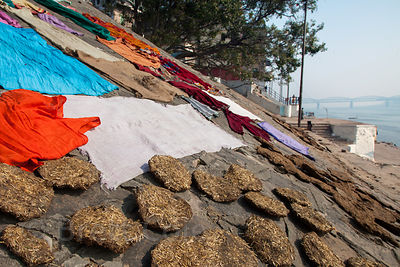 Dung patties (for fuel) and laundry drying, Varanasi, India.