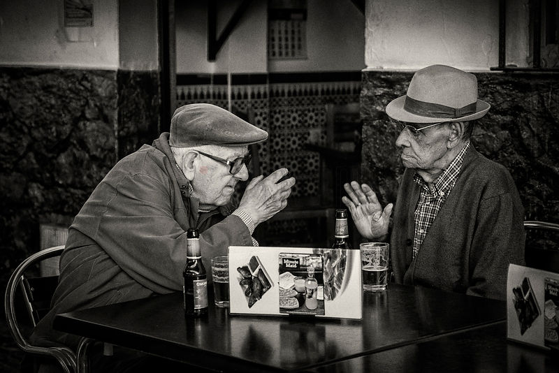 Two Elderly Men in Conversation