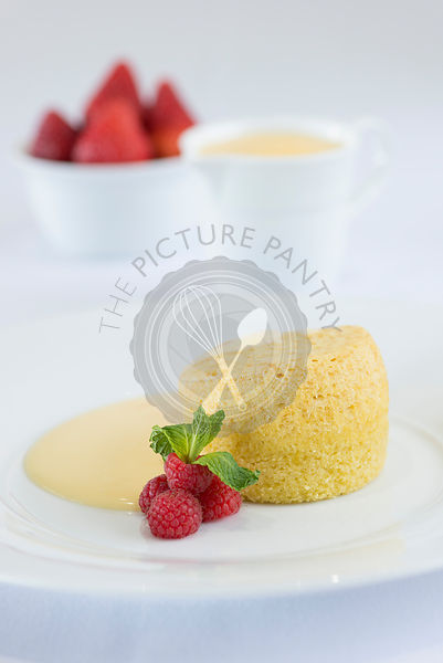 Sponge pudding, custard and strawberries