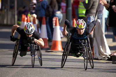 Susannah Scaroni (4th) of USA racing neck and neck with Christie Dawes (5th) of Australia in the Womens Wheelchair Event